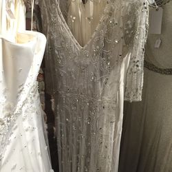 Beaded bridal gown, $3,500 (was $7,025).