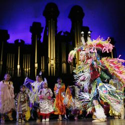 Lane Neaman with First Nation Li'l Feathers dances during the Interfaith Musical Tribute to the Human Spirit at the Tabernacle in Salt Lake City, Utah, Sunday, Feb. 8, 2009.