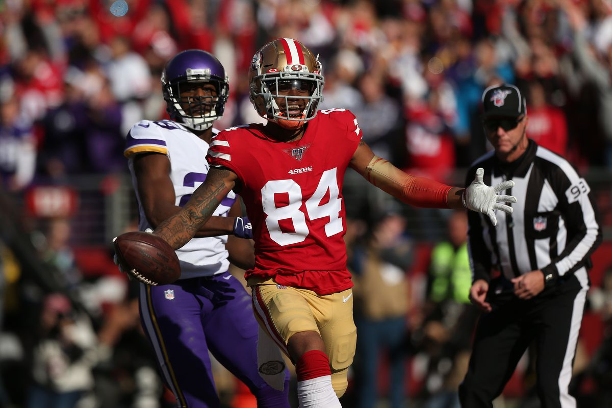 San Francisco 49ers wide receiver Kendrick Bourne  reacts after catching a touchdown pass against the Minnesota Vikings in the first quarter in a NFC Divisional Round playoff football game at Levi's Stadium