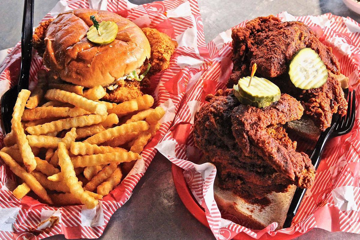On the left is a basket with a fried chicken sandwich with a pickle on top, plus fries. On the right are too pieces of chicken covered in a dry rub, also with pickle slices, on top of slices of bread.