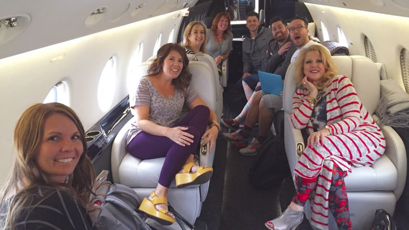A group of white people on a jet.