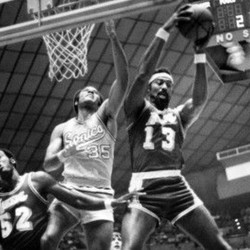 Zaid Abdul-Aziz, then known as Don Smith when he played for the Sonics, goes against Wilt Chamberlin in a 1971 game in the Seattle Center Coliseum.