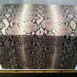 A snakeskin jewelry case.