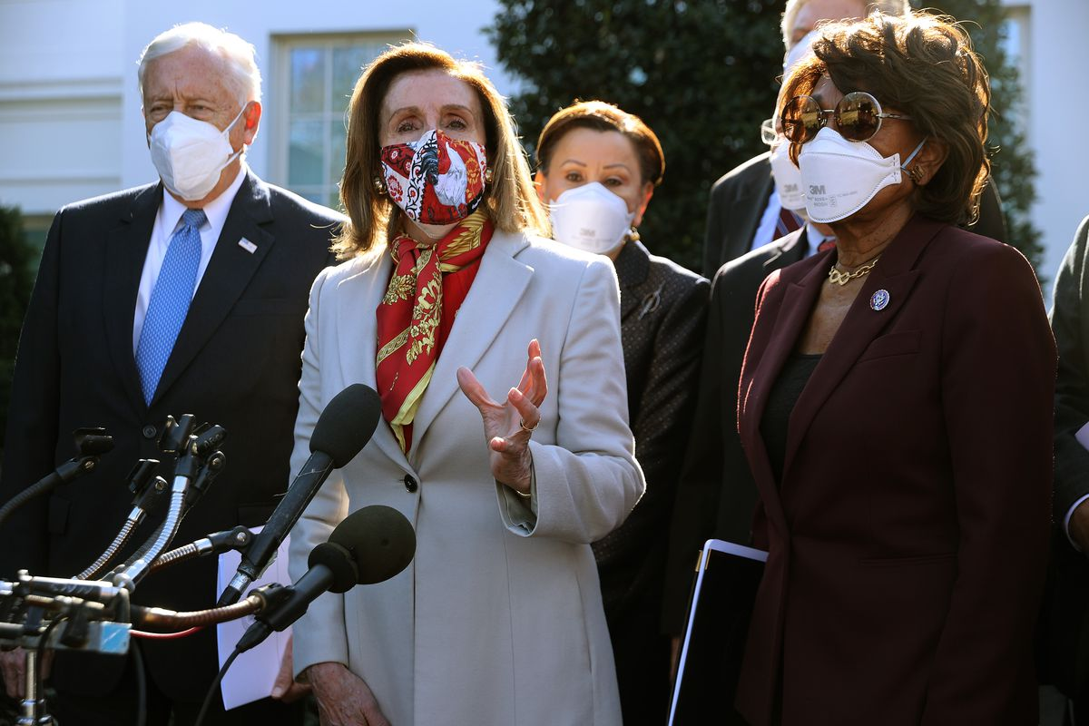 Nancy Pelosi speaking at a podium outdoors surrounded by other members of Congress.