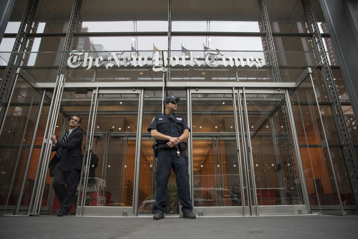 In this June 28, 2018, file photo, a police officer stands outside The New York Times building in New York. The Trump Justice Department secretly obtained the phone records of four New York Times journalists as part of a leak investigation, the newspaper said Wednesday, June 2, 2021.