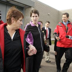 Pamela Mortensen, center, was released from the Utah County Jail in Spanish Fork Dec. 8, 2010, escorted by her mother and sister. She and her husband were wrongly accused of murder in the death of Roger Mortensen's father, Kay Mortensen. A lawsuit they filed against police and prosecutors has been dismissed.