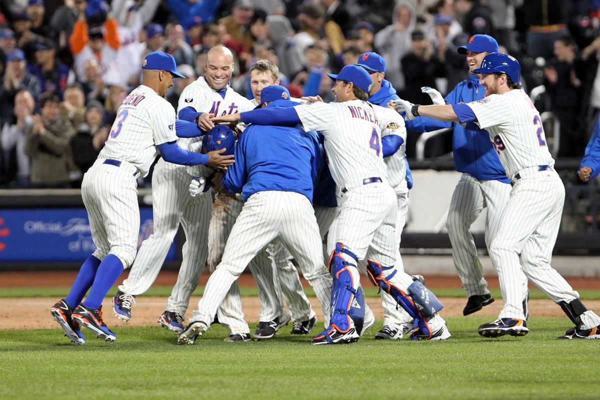 Apr 09, 2012; Flushing, NY,USA;  New York Mets celebrate their win over against the Washington Nationals at Citi Field.  Mets won 4-3.  Mandatory Credit: Anthony Gruppuso-US PRESSWIRE