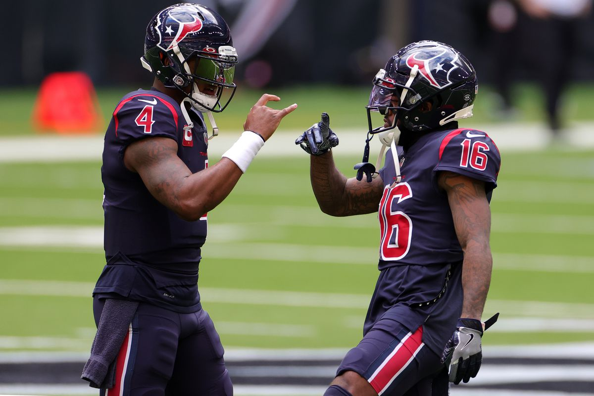 Deshaun Watson #4 of the Houston Texans and wide receiver Keke Coutee #16 warm up prior to the game against the Cincinnati Bengals at NRG Stadium on December 27, 2020 in Houston, Texas.