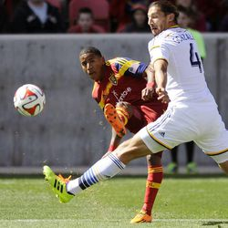 Real Salt Lake forward Joao Plata (8) kicks the ball around the defense of Los Angeles Galaxy defender Omar Gonzalez (4) during a game at Rio Tinto Stadium on Saturday, March 22, 2014.
