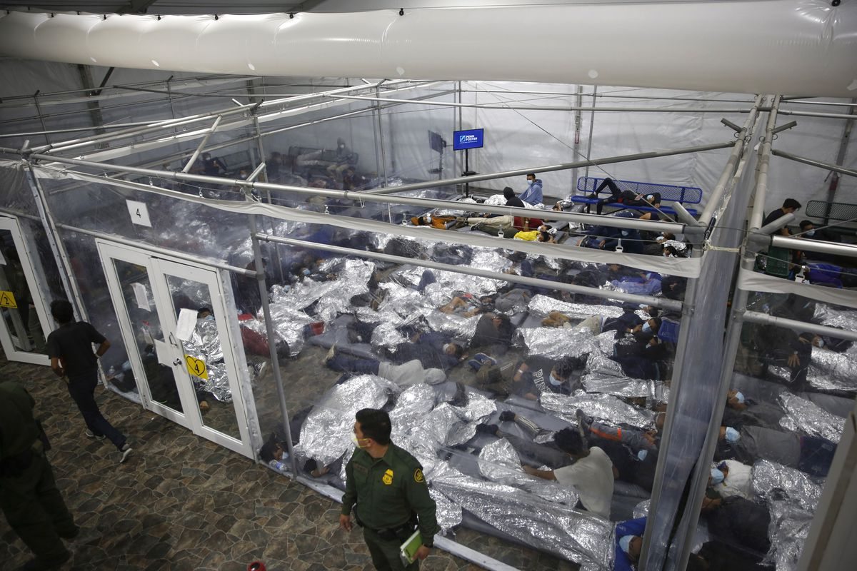 In this March 30, 2021, file photo, minors lie inside a pod at the Donna Department of Homeland Security holding facility, in Donna, Texas.
