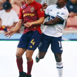 Real Salt Lake defender Donny Toia (4) and Vancouver Whitecaps forward Cristian Dajome (11) go up for the ball as Real Salt Lake and Vancouver FC play at Rio Tinto Stadium in Sandy on Wednesday, July 7, 2021.