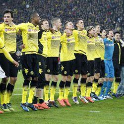 Dortmund's players celebrate winning the German soccer championship after winning 2-0 in the German first division Bundesliga soccer match between Borussia Dortmund and Borussia Moenchengladbach in Dortmund, Germany, Saturday, April 21, 2012.