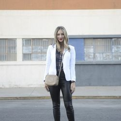 """Emily of <a href=""""http://cupcakesandcashmere.com""""target=""""_blank"""">Cupcakes and Cashmere</a> is wearing a Rag & Bone blazer, a J.Crew shirt, a Gucci bag, Robert Rodriguez leather pants and Manolo Blahnik pumps."""