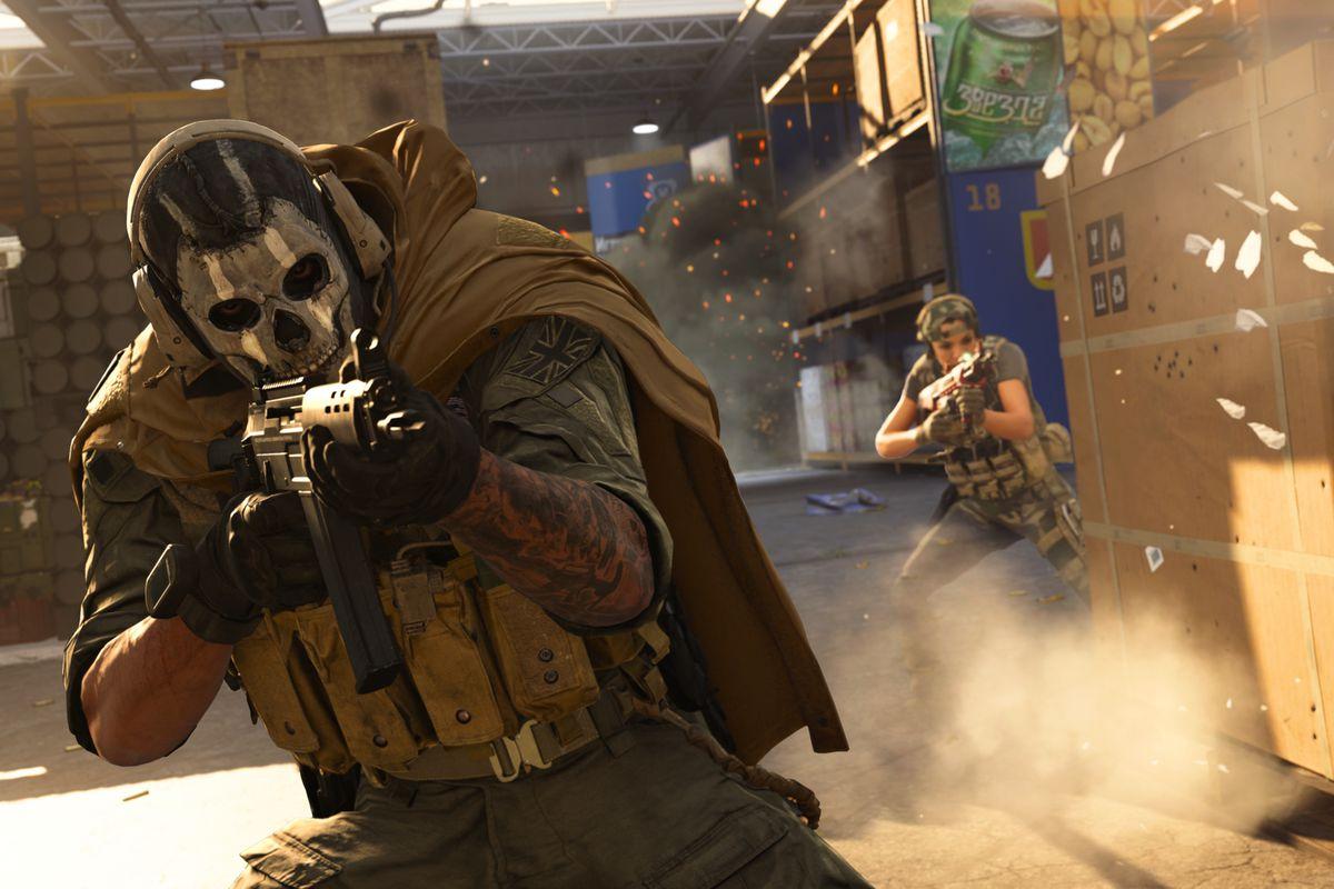 Two players battle in a warehouse in a screenshot from Call of Duty: Modern Warfare season 2