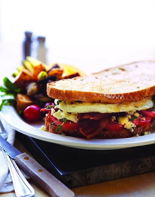 """The signature <span data-author=""""-1"""">""""Fannie's Killer Fried Egg Sandwich,"""" with eggs, bacon, tomatoes, and Gorgonzola.</span>"""