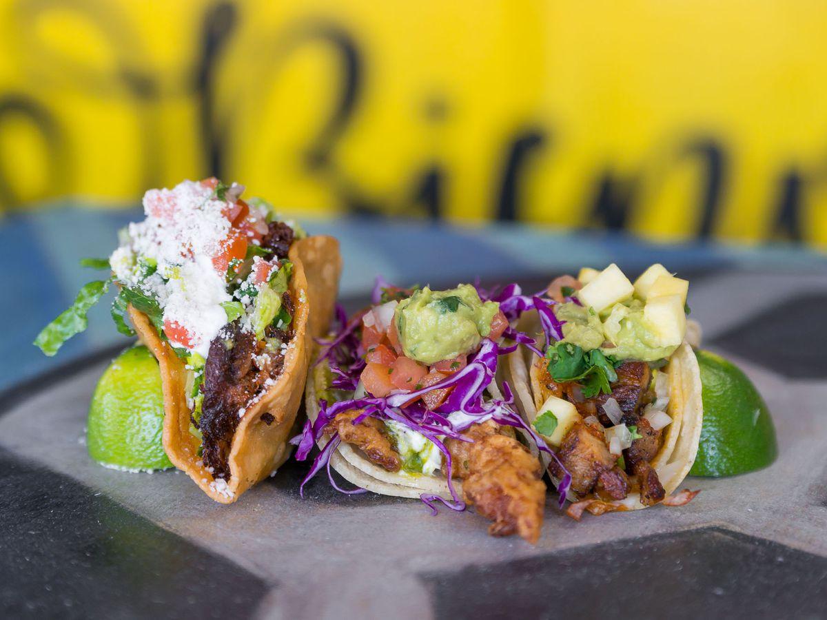 Braised brisket, rock shrimp, and al pastor tacos at Bomb Tacos.