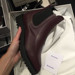 Rubber leather boots, $255 (were $850)