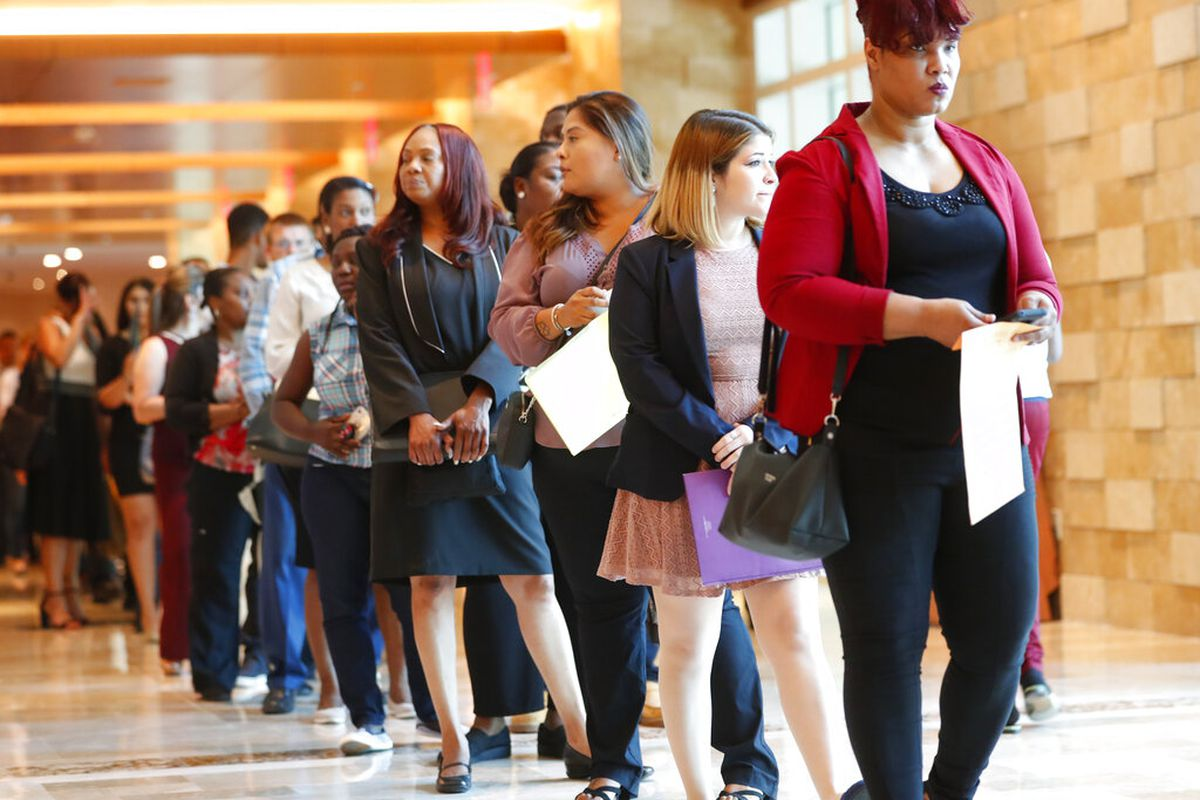 Job applicants wait in line during a job fair in Hollywood, Florida