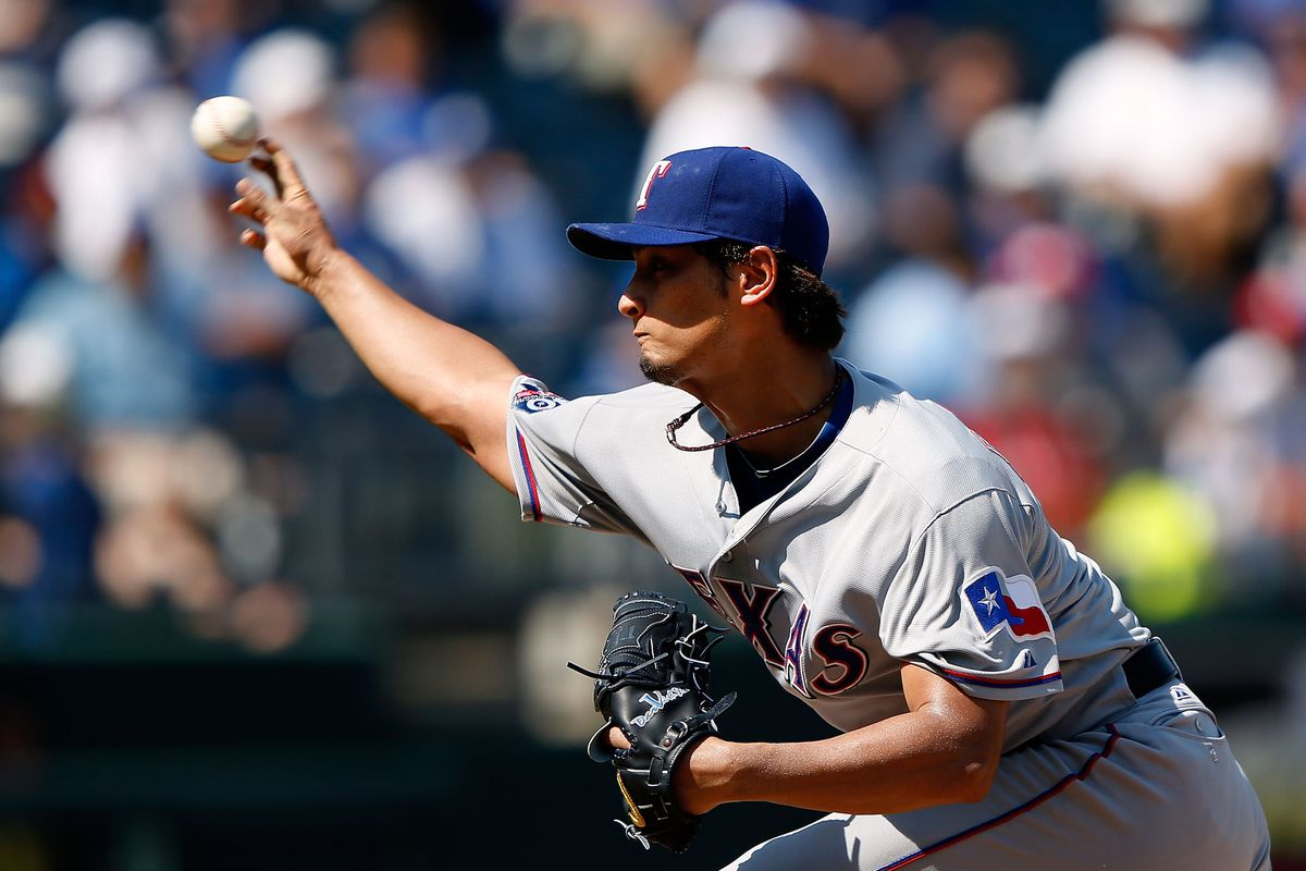 KANSAS CITY, MO - SEPTEMBER 03:  Starting pitcher Yu Darvish #11 of the Texas Rangers pitches during the game against the Kansas City Royals at Kauffman Stadium on September 3, 2012 in Kansas City, Missouri.  (Photo by Jamie Squire/Getty Images)