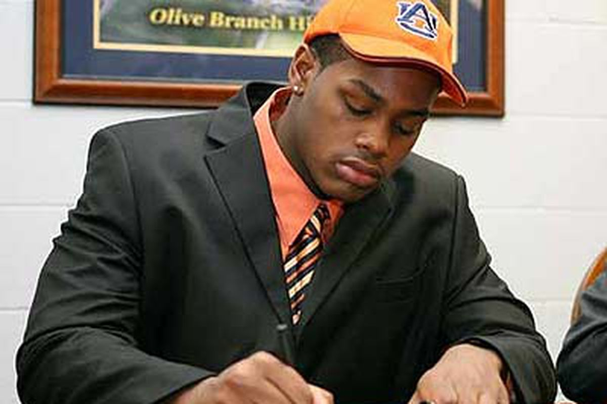 """February, 2010 - Shon Coleman, 6'7"""" 285 lb. 5-star offensive lineman signs his letter of intent to play football for Auburn University. (<em>photo, Chris Evans-cbs sports</em>)"""
