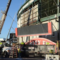 3:21 p.m. The third segment of the marquee being lowered onto the flatbed truck -