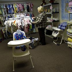 Melinda Oberhelman, executive director of the Pregnancy Resource Center of Utah Valley, sorts through baby clothes in the Orem facility's basement.