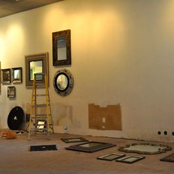 Mirrors laid out, ready to go up on the walls.