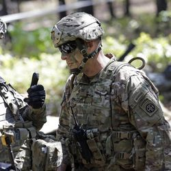 In this photo taken Friday, April 21, 2017 Col. Gregory Beaudoin, right, commander of the 82nd Airborne Division's 3rd Brigade Combat Team speaks with troops during a training exercise at Fort Bragg, N.C. Struggling to expand its ranks, the Army will triple the amount of bonuses it's paying this year to more than $380 million, including new incentives to woo reluctant soldiers to re-enlist, officials told The Associated Press.