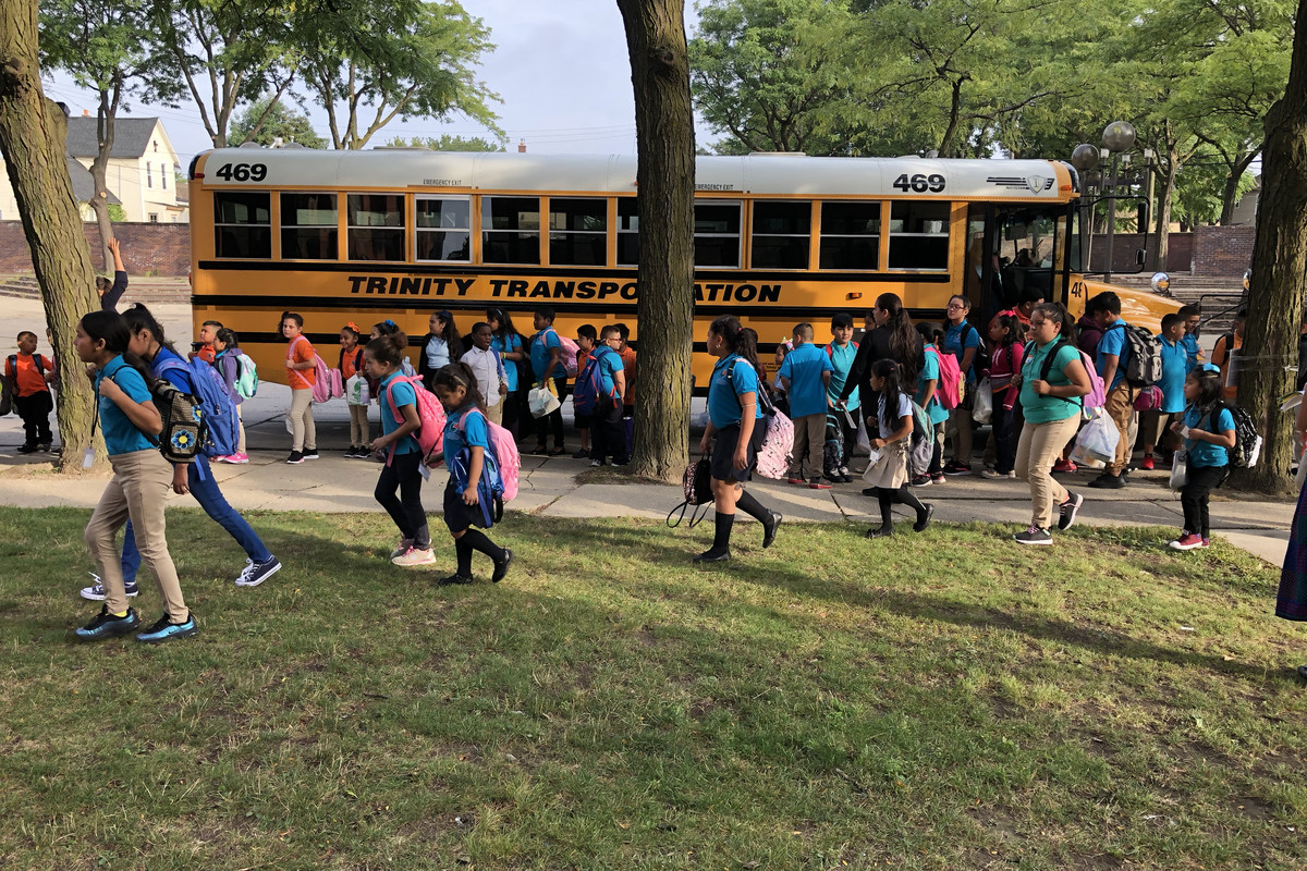Students arrive at Escuela Avancemos, a Detroit charter, on the first day of school in 2019.