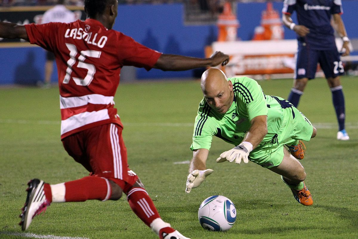 FRISCO, TX - JUNE 04:  Matt Reis #1 of the New England Revolution makes a save against Fabian Castillo #15 of FC Dallas at Pizza Hut Park on June 4, 2011 in Frisco, Texas.  (Photo by Ronald Martinez/Getty Images)