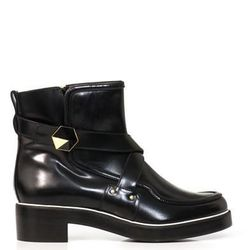 """<a href=""""http://www.matchesfashion.com/product/159496"""">Leather biker boots by Nicholas Kirkwood</a>, $337.00 (were $1,055)"""