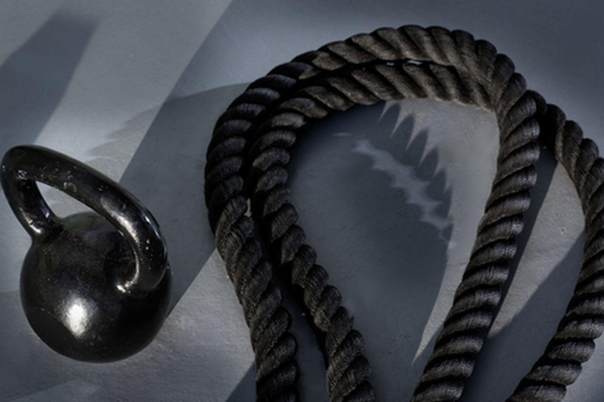 "Image via <a href=""http://www.shutterstock.com/pic-124887568/stock-photo-fitness-kettlebell-and-battle-rope-on-the-gym-floor.html?src=k_UkRZZP3fdVoVjDr7NBaw-1-46"">holbox</a>/Shutterstock"