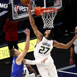Utah Jazz center Rudy Gobert (27) blocks the ball after Dallas Mavericks forward Kristaps Porzingis (6) shoots as the Utah Jazz and the Dallas Mavericks play an NBA basketball game at Vivint Smart Home Arena in Salt Lake City on Wednesday, Jan. 27, 2021. Jazz won 116-104.