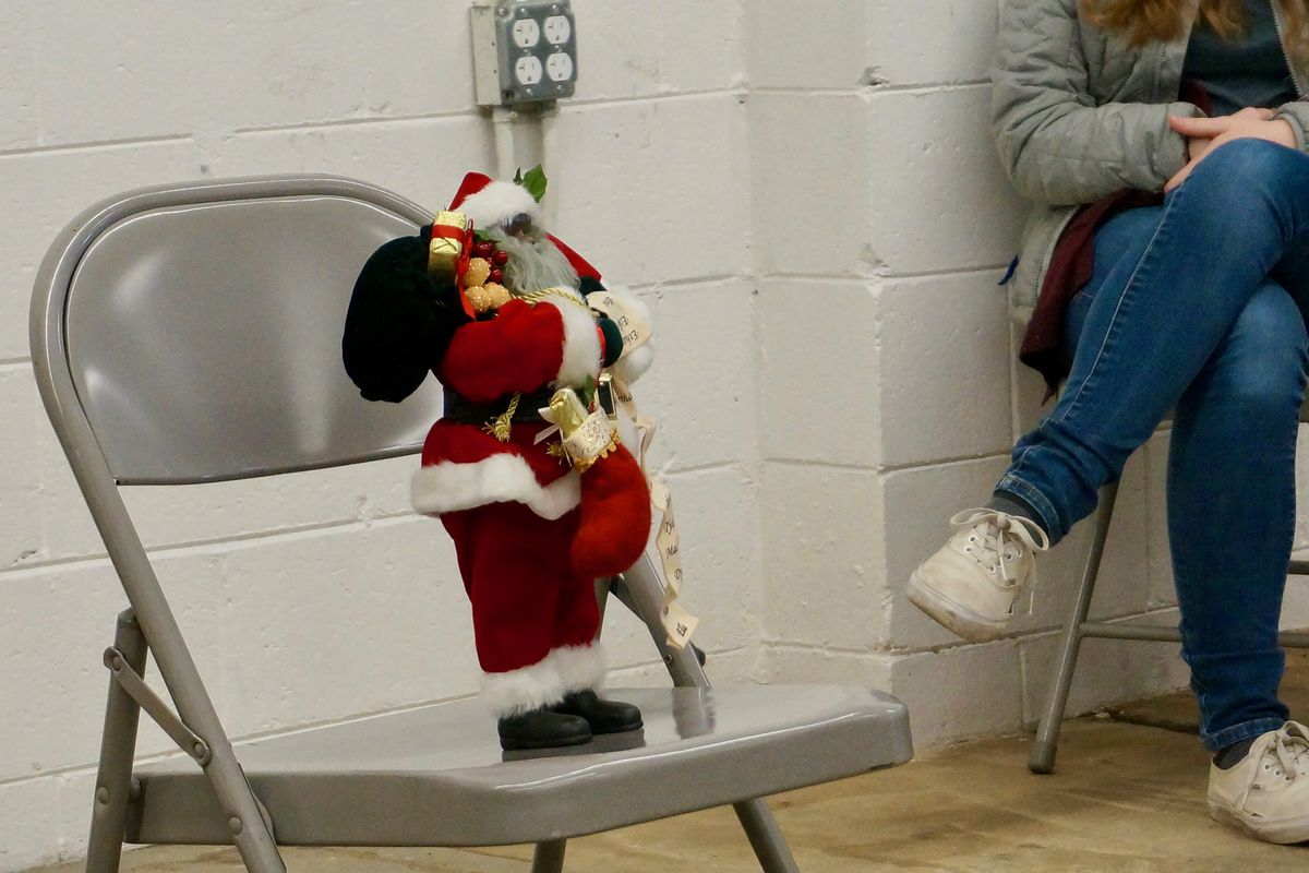 Black Santa rests on a folding chair at a Teacher Story Slam event last month.