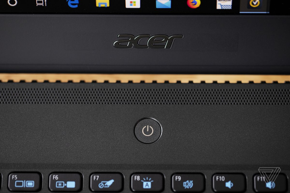 The Acer logo and power button on the Acer TravelMate P6.