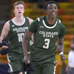 Colorado State guard Kendle Moore (3) smiles as he and forward James Moors (10) run off the court after the team's win over Utah State in an NCAA college basketball game Thursday, Jan. 21, 2021, in Logan, Utah.