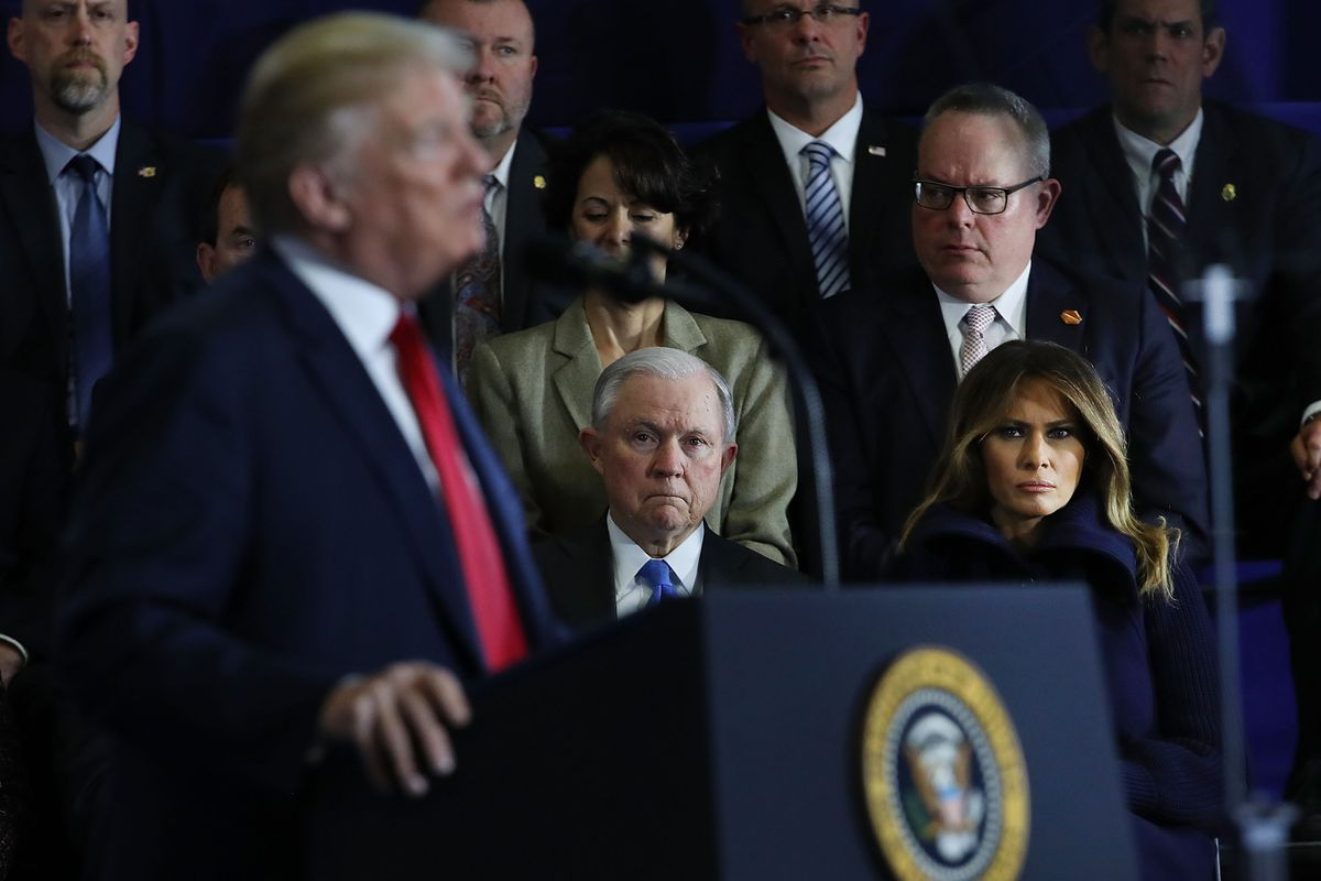 Trump and Sessions at a March speech.