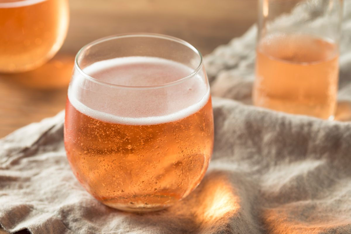 A glass of wine sits on a linen cloth