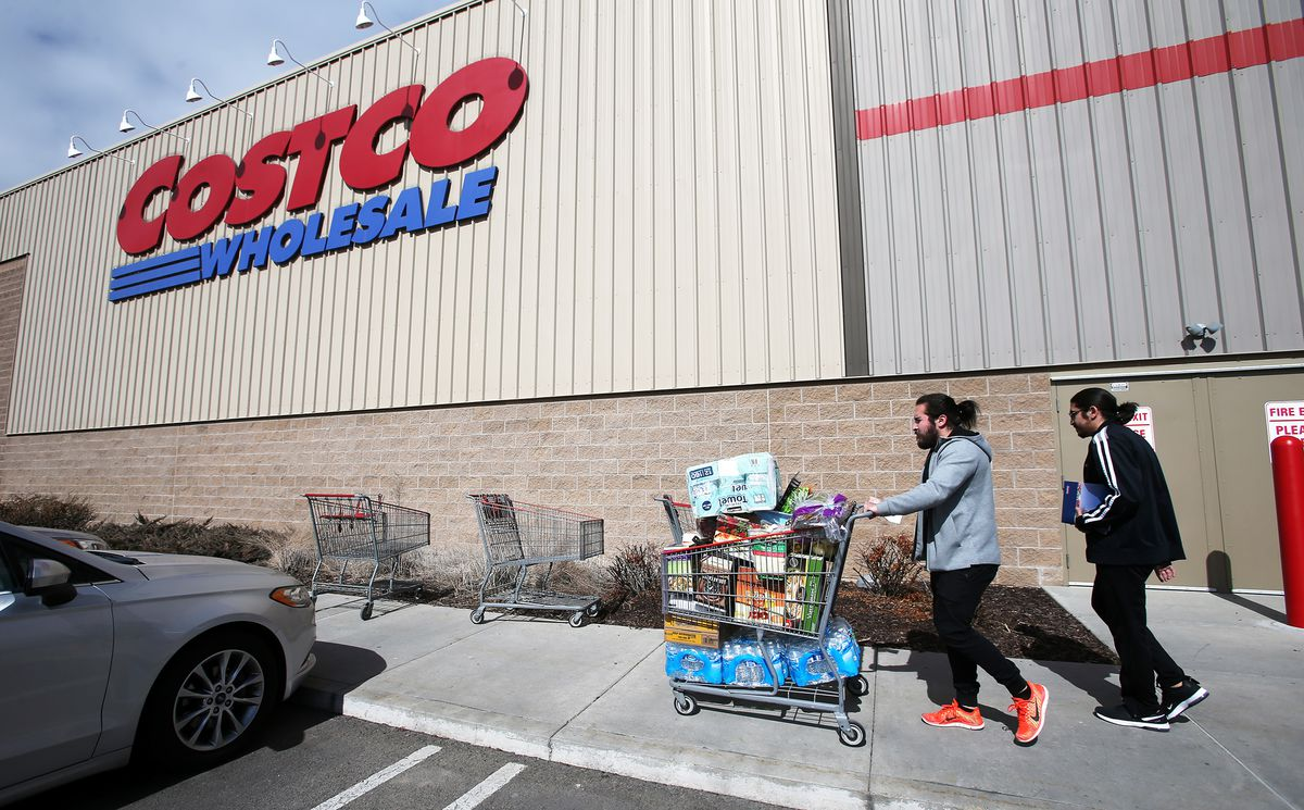 Jared Camberos and Jordi Camberos take water, toilet tissue and other items to their car as they and other shoppers at the Lehi Costcoprepare themselves over coronavirus concerns on Tuesday, March 3, 2020. Shoppers are being told that they can only buy up to five cases of water and up to three cases of toilet tissue from that store.