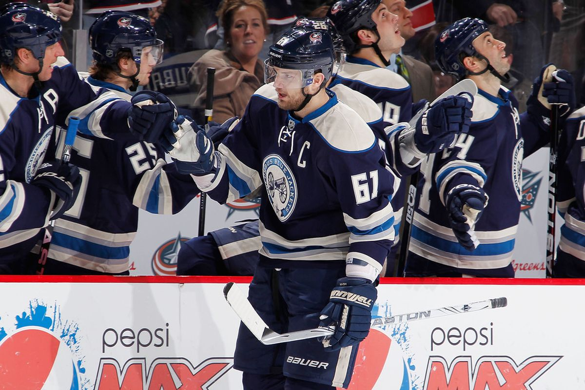 Rick Nash #61 of the Columbus Blue Jackets celebrates a third period goal with teammates while playing the San Jose Sharks at Nationwide Arena in Columbus, Ohio. The San Jose Sharks won the game 2-1. (Photo by Gregory Shamus/Getty Images)