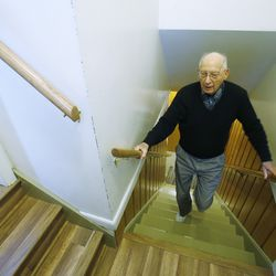 Roger Thompson, 99, walks from the basement at his home in Salt Lake City Friday, Dec. 3, 2013.