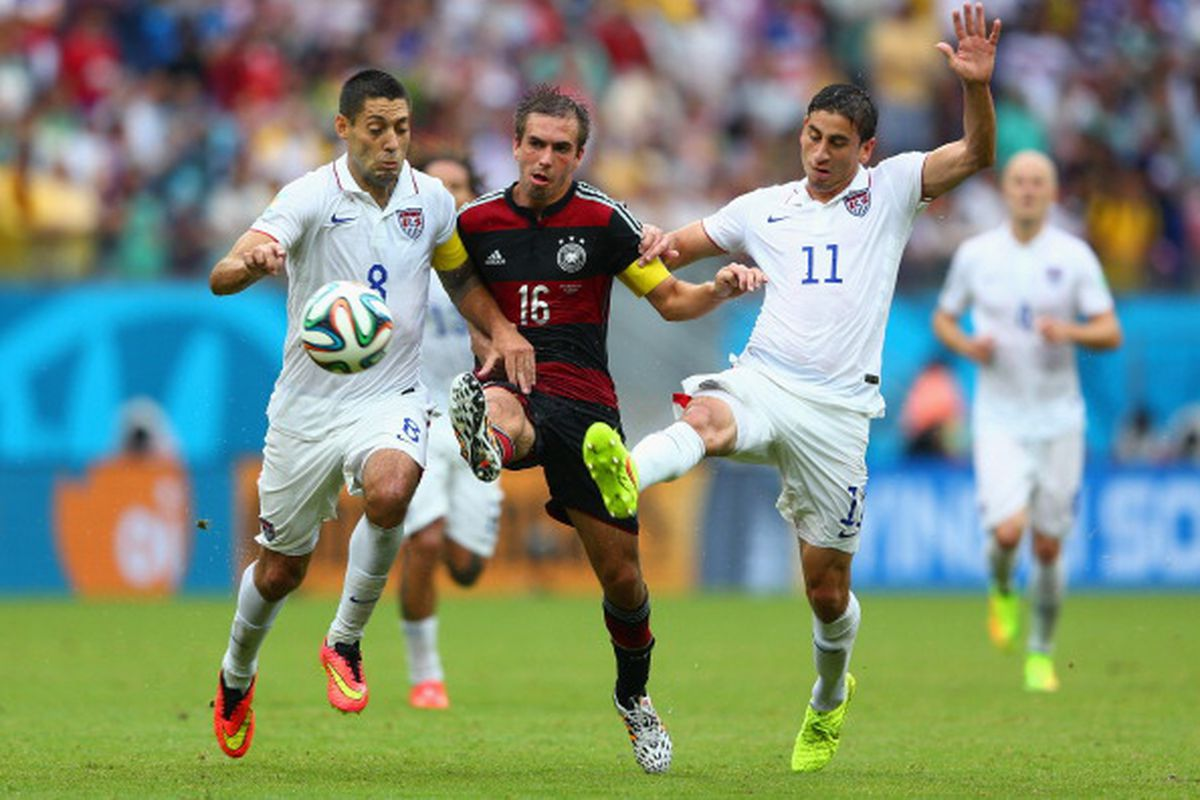 Philipp Lahm of Germany is challenged by Clint Dempsey (L) and Alejandro Bedoya of the United States during the 2014 FIFA World Cup Brazil group G match between the United States and Germany at Arena Pernambuco on June 26, 2014 in Recife, Brazil.