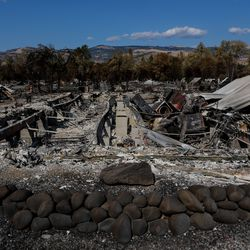 The remains of a home in the Mountain View Estates neighborhood, a manufactured home community for seniors in Talent, Ore., is pictured on Saturday, Sept. 19, 2020, after being nearly completely burned by the Almeda Fire.