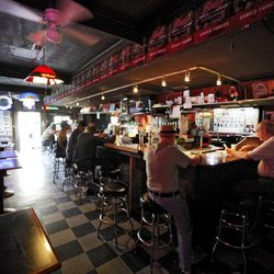 In this photo taken Friday, Sept. 7, 2012, patrons are seen at the King Eddy Saloon, one of the oldest and most colorful dive bars in Los Angeles. The King Eddy Saloon located near the Skid Row will close next September after more than 100 years as a bar.