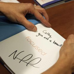 """Olympic silver medalist Noelle Pikus-Pace signs a books for Cathy Jeppsen during a small group discussion about Pace's new book, """"Focused: Keeping Your Life on Track, One Choice at a Time,"""" at Deseret Book corporate headquarters, Tuesday, Sept. 9, 2014."""