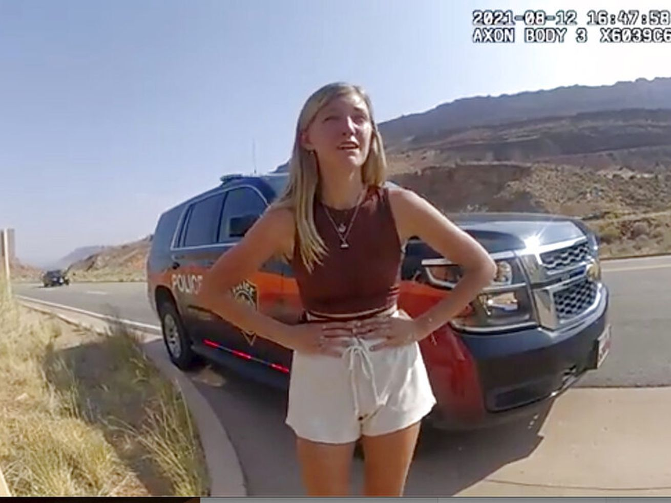 """Gabrielle """"Gabby"""" Petito talks to a police officer near the entrance to Arches National Park."""