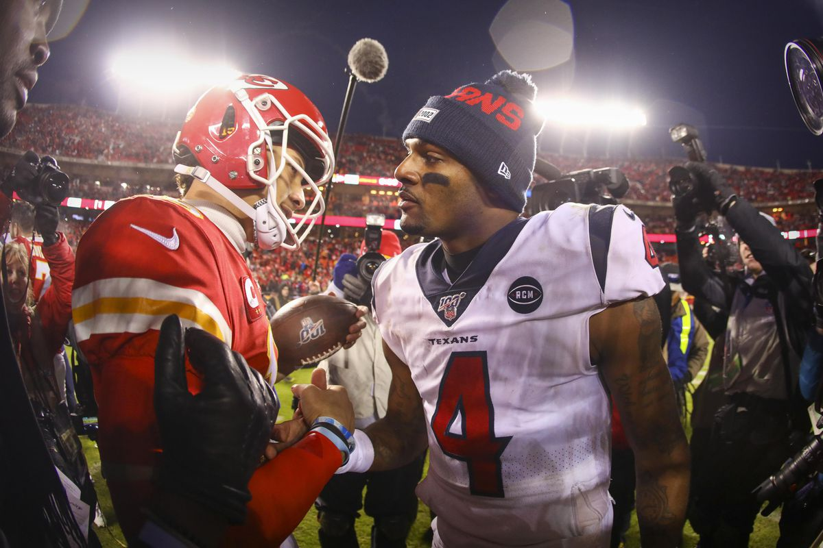 Kansas City Chiefs quarterback Patrick Mahomes hugs Houston Texans quarterback Deshaun Watson after the game between the Chiefs and the Texans in a AFC Divisional Round playoff football game at Arrowhead Stadium.
