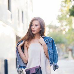 "Jenny of <a href=""http://www.neonblush.com""target=""_blank"">Neon Blush</a> is wearing an H&M top, a Zara skirt, a Wrangler denim jacket and a Saint Laurent bag."