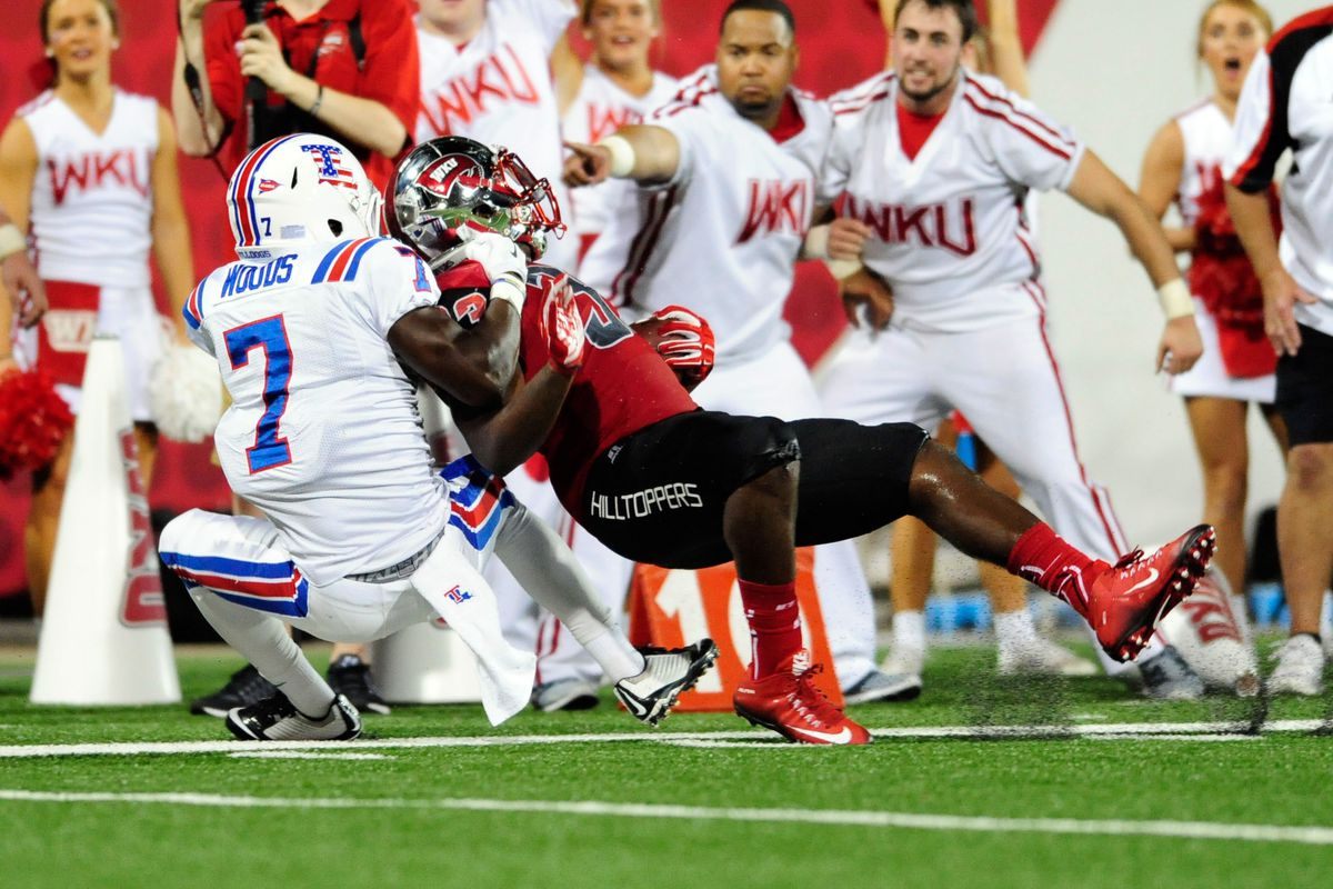 Xavier Woods of Louisiana Tech looks to bring down a Jim Thorpe for the Underdogs
