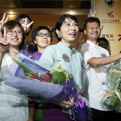 Claudia Mo Man-ching, center, of the pro-democracy Civic Party celebrates with her supporters after winning at a seat on the Legislative Council in Hong Kong, Monday, Sept. 10, 2012. Hong Kong voters cast ballots in legislative elections Sunday that will help determine the eventual shape of full democracy that Beijing has promised the former British colony.
